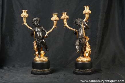 Paire française Empire Chérubin bronze doré au mercure Candélabres