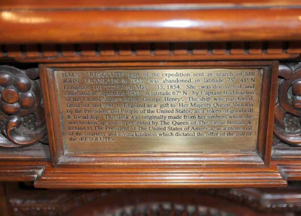 Commemorative plaque on back of Presidents desk