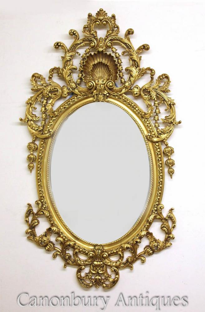 Cadre doré de style Rococo miroir ovale grand Français Louis XVI