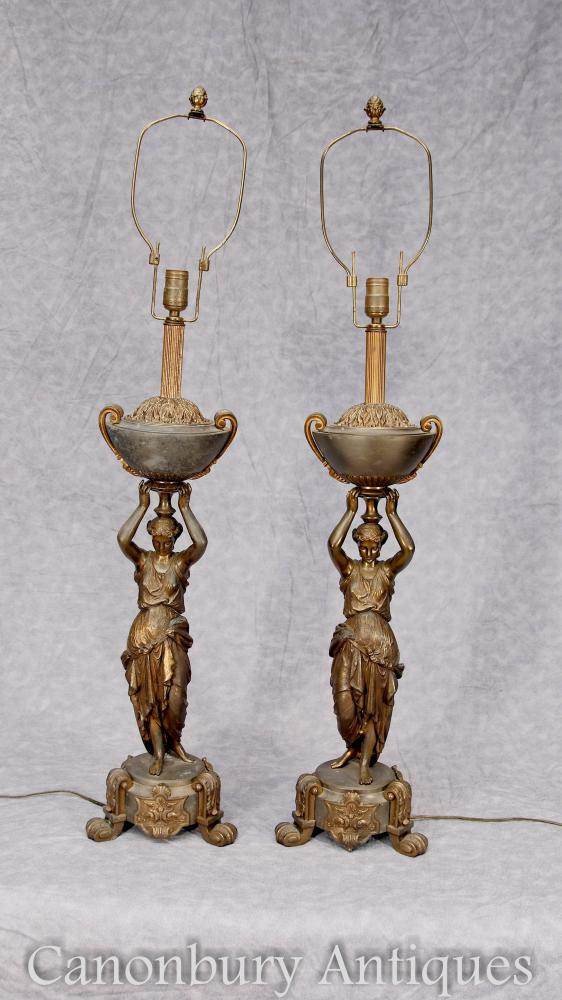 Parell de llums antics de bronze femení de taula de taula