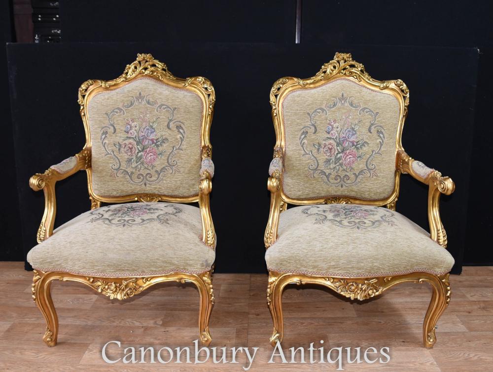 Paire de chaises à bras dorés français Louis XVI