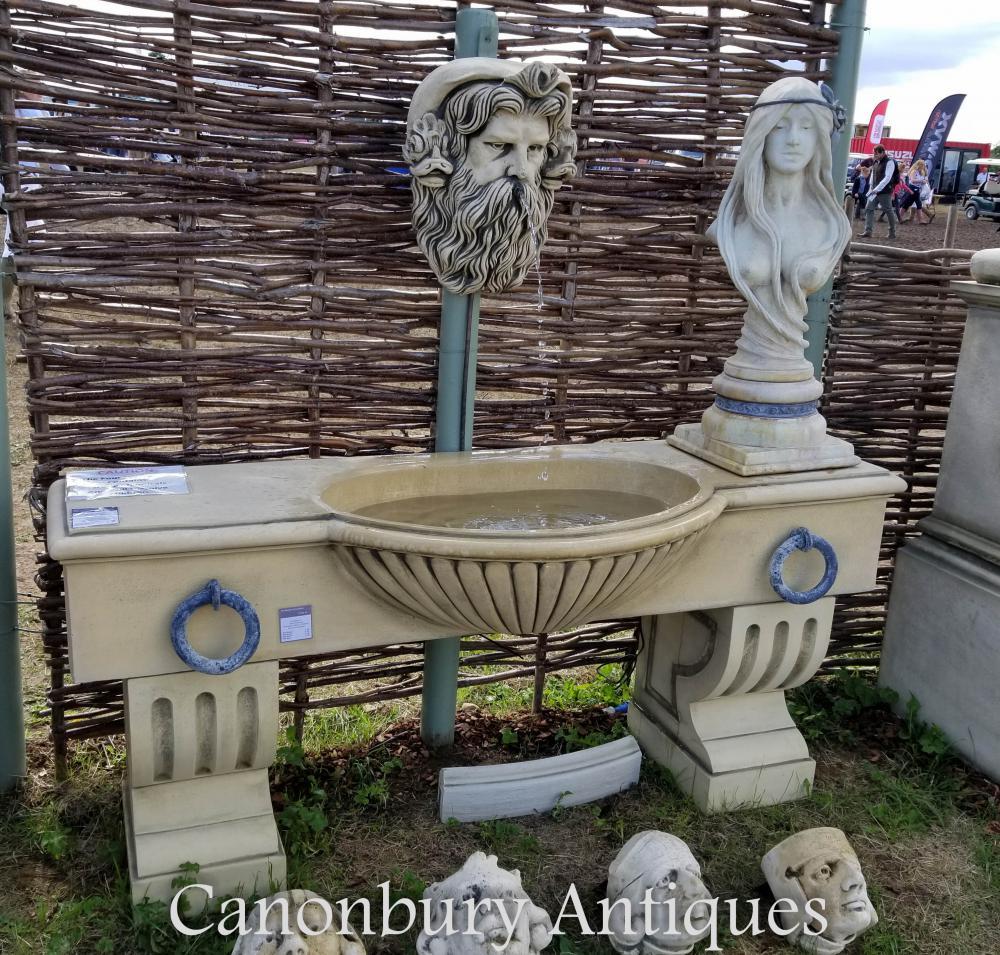 Fontaine de mur en pierre de l'eau en pierre anglaise Neptunes Head