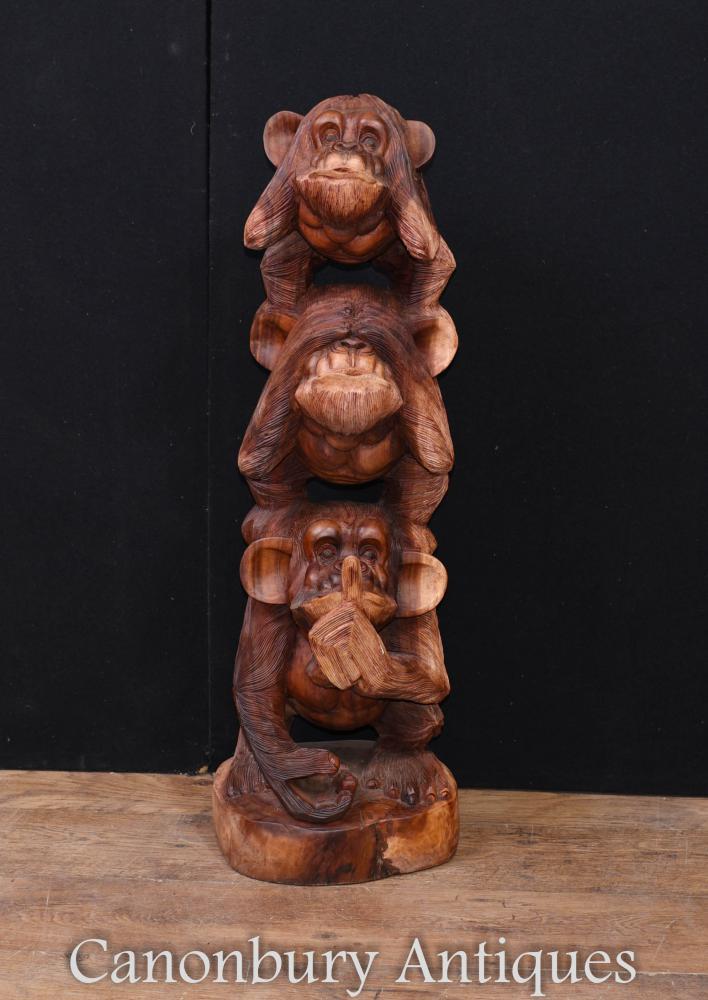 Grand singe découpant Voir entendre parler aucun singe maléfique de chimpanzé