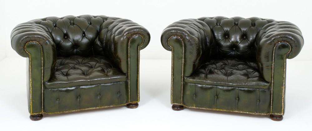 Paire de fauteuils à bras profond en cuir antique
