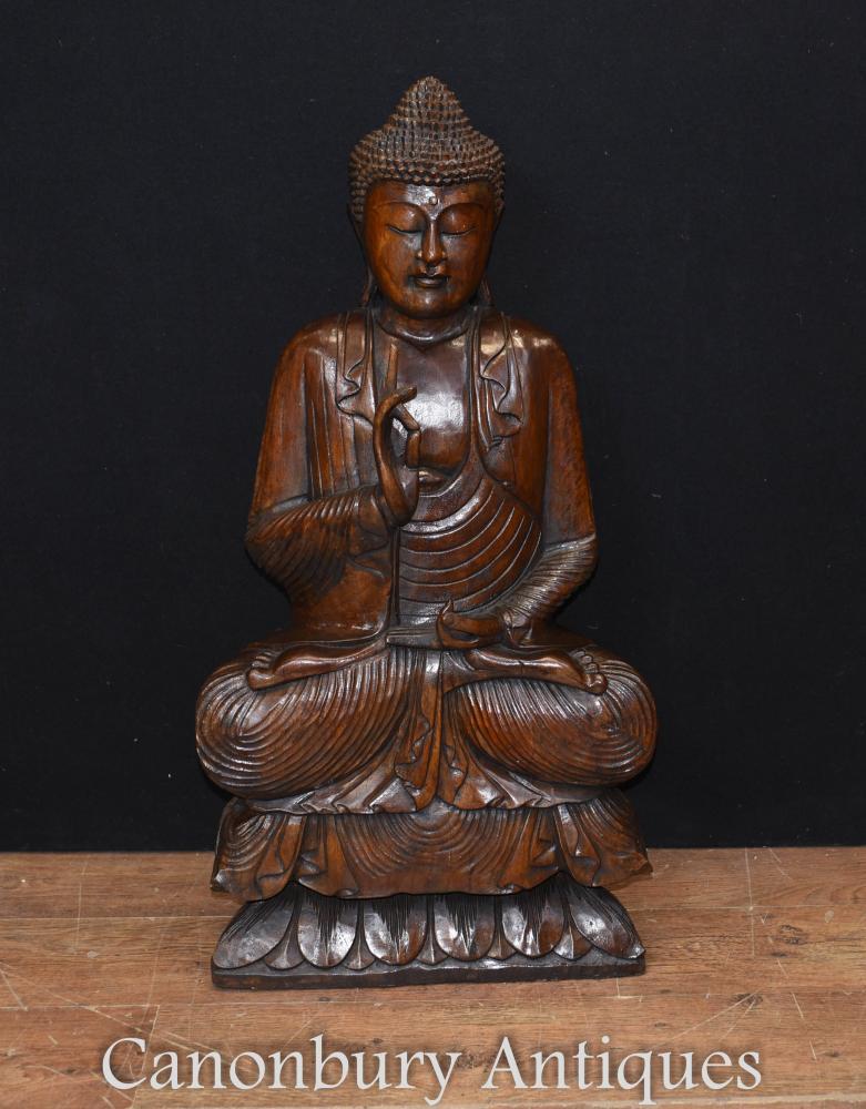 Bouddhisme, grande statue de Bouddha tibétain sculptée à la main