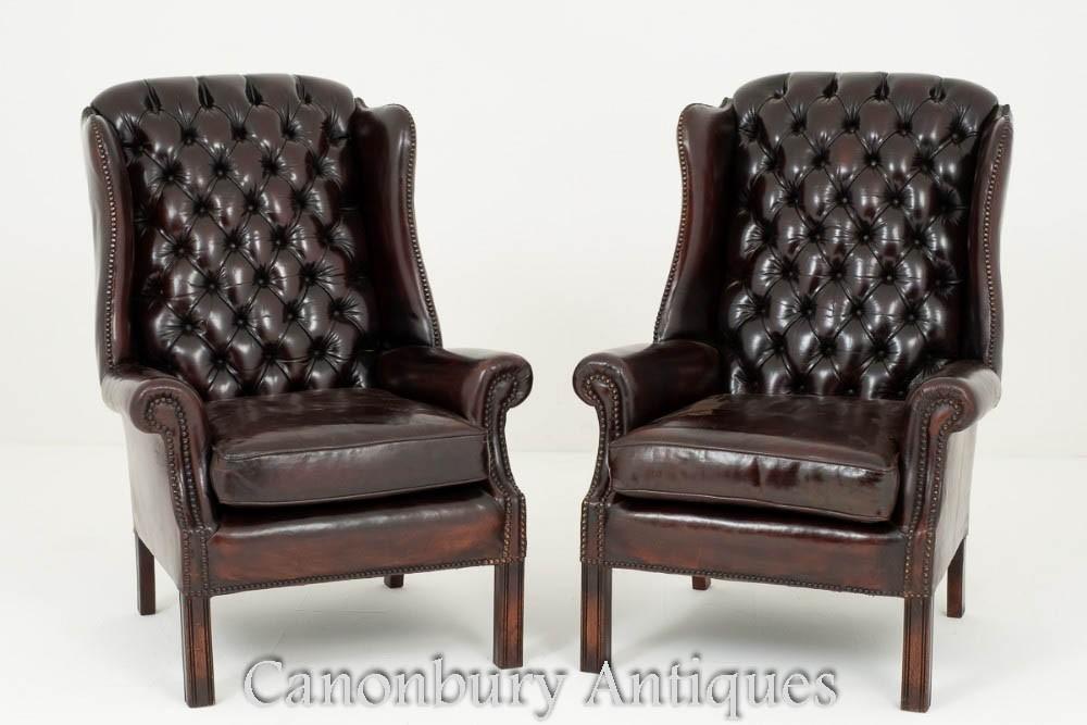 Paire de fauteuils à oreilles anglais, fauteuil à boutons profonds en cuir